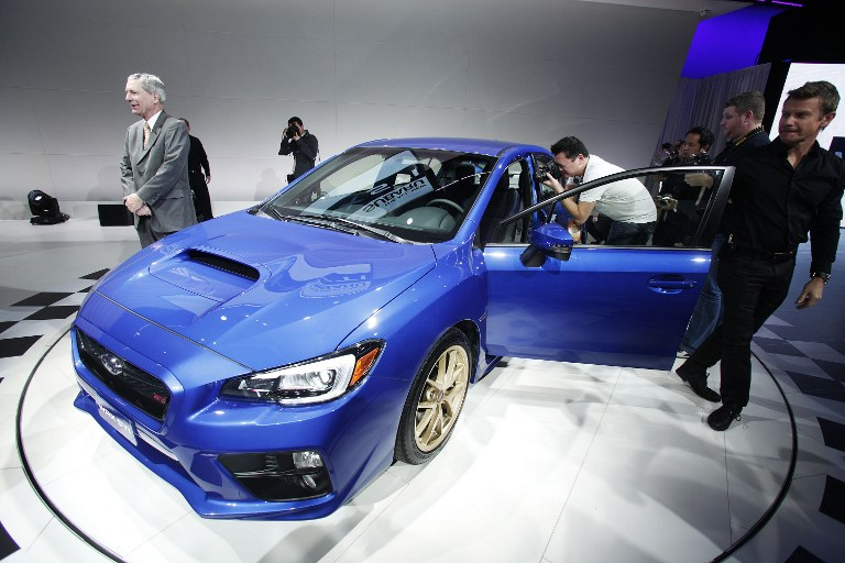 The new Subaru WRX STi is introduced at the press preview of the 2014 North American International Auto Show January 14, 2014 in Detroit, Michigan.