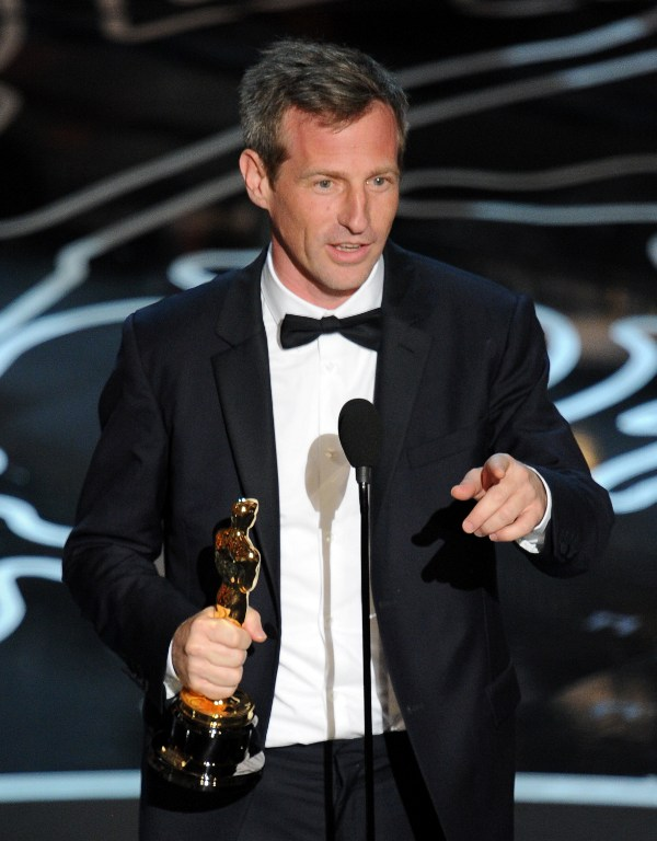 Screenwriter/director Spike Jonze accepts the Best Screenplay Written Directly for the Screen award for 'Her'