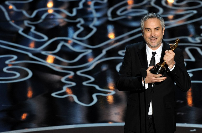 Director Alfonso Cuaron accepts the Best Achievement in Directing award for 'Gravity'