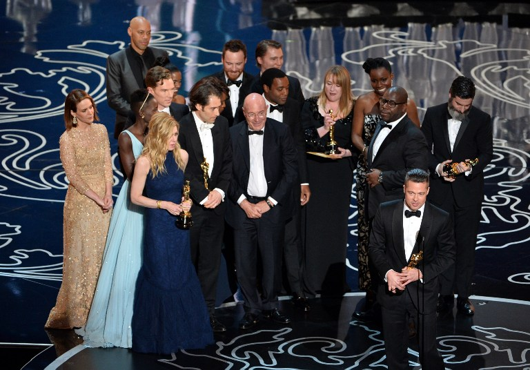 Actor/producer Brad Pitt (lower right) accepts the Best Picture award for '12 Years a Slave'
