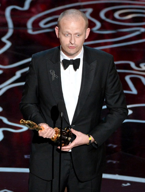 Editor Mark Sanger accepts the Best Achievement in Editing award for 'Gravity'.©AFP
