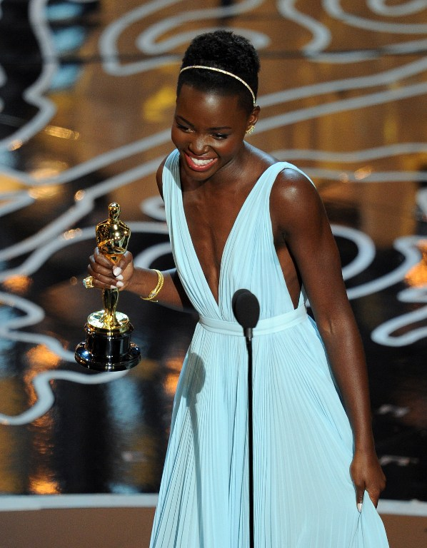 Actress Lupita Nyong'o accepts the Best Performance by an Actress in a Supporting Role award for '12 Years a Slave'