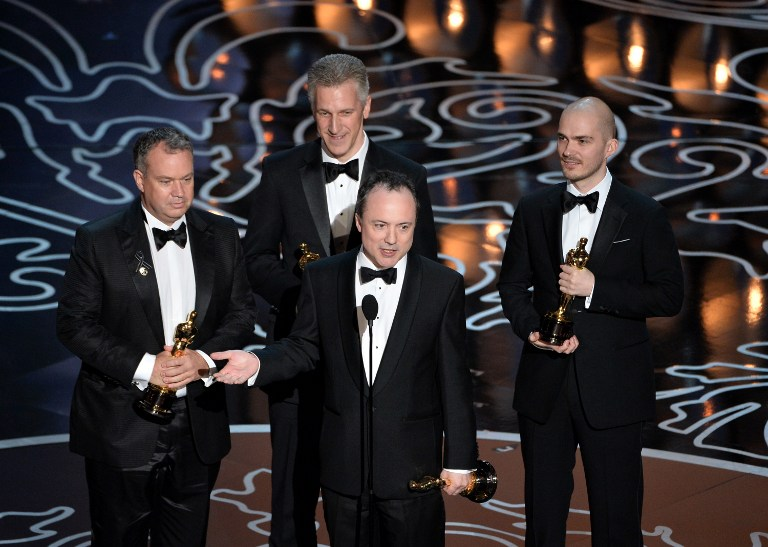 Visual effects artists Neil Corbould, David Shirk, Timothy Webber, and Chris Lawrence accept the Best Achievement in Visual Effects award for 'Gravity'