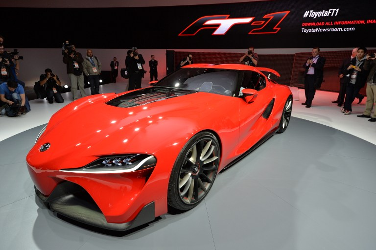 Members of the media get a look at the Toyota FT-1 concept car during a press preview at the North American International Auto Show January 13, 2014 in Detroit, Michigan.