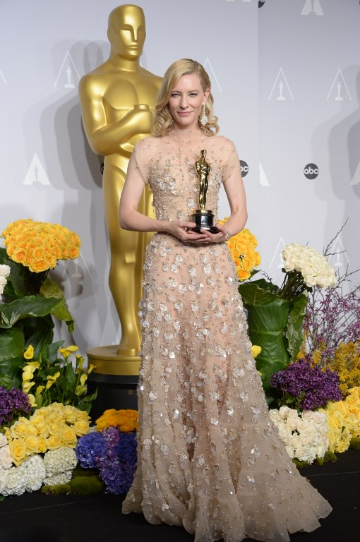 Actress Cate Blanchett poses in the press room after winning best actress Oscar for her turn in Woody Allen's