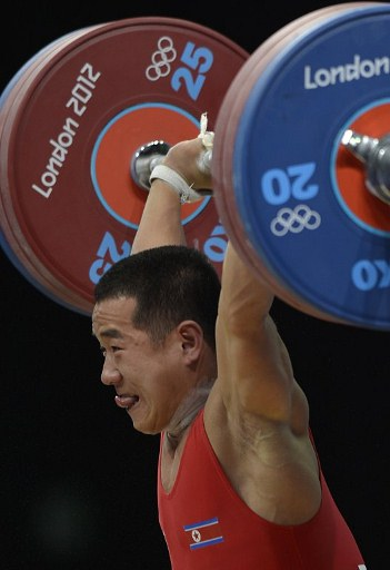 North Korea's Om Yun Chol competes during the weightlifting men's 56kg group B. ©AFP
