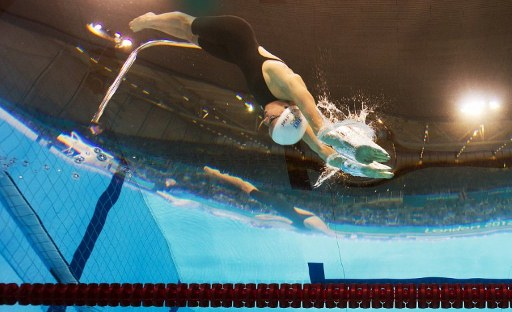 France's Camille Muffat competes in the women's 200m freestyle final. ©AFP