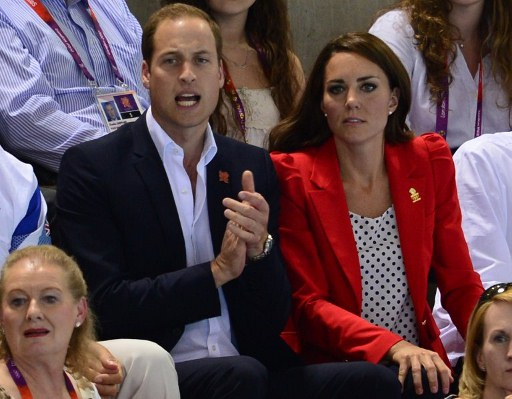 Britain's Prince William, the Duke of Cambridge and Catherine, Duchess of Cambridge react during the women's 800m freestyle final. ©AFP