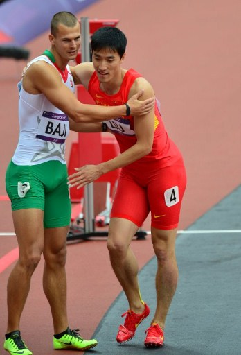 China's Liu Xiang (R) is conforted by Hungary's Balazs Baji (L). ©AFP