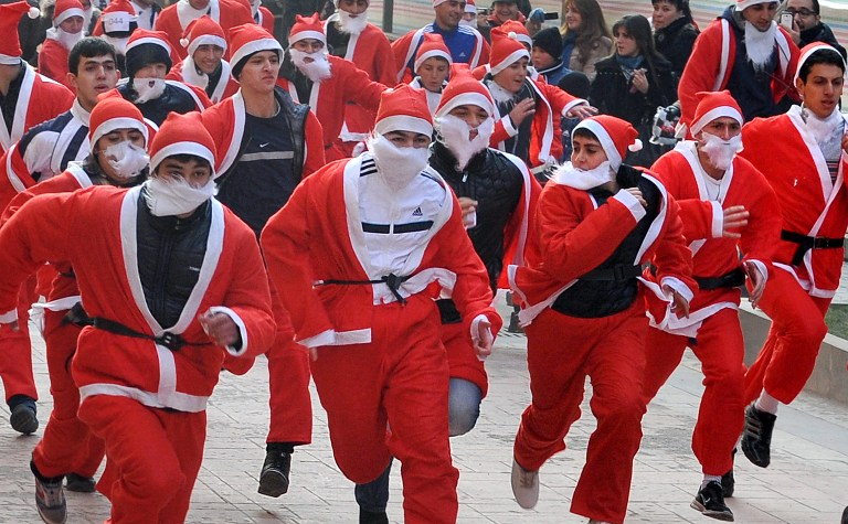Runners dressed as Father Christmas participate in a 'Santa Run' fun run in the Armenian capital Yerevan. ©AFP