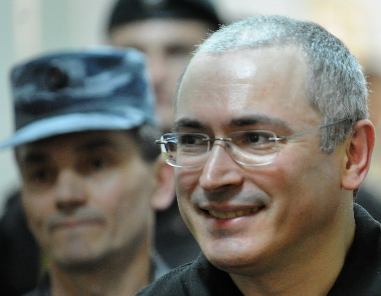 A file picture on June 3, 2011, shows former Yukos oil company CEO Mikhail Khodorkovsky is being escorted to a courtroom in Moscow. Khodorkovsky was set to be freed in August 2014 after spending more than a decade in jail on fraud and tax evasion charges.