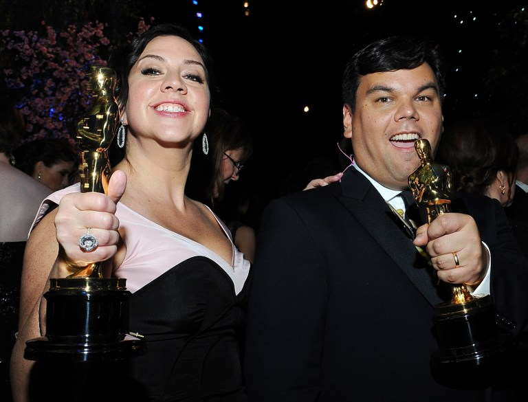 Songwriters Kristen Anderson-Lopez (L) and Robert Lopez, winners of the Best Achievement in Music Written for Motion Pictures, Original Song award for 'Let It Go' from 'Frozen'