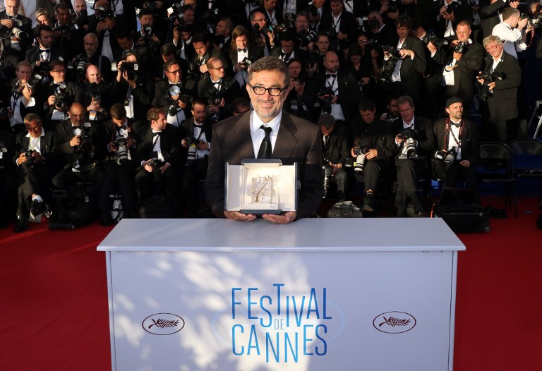 Turkish director Nuri Bilge Ceylan poses with the Palme d'Or which he won for