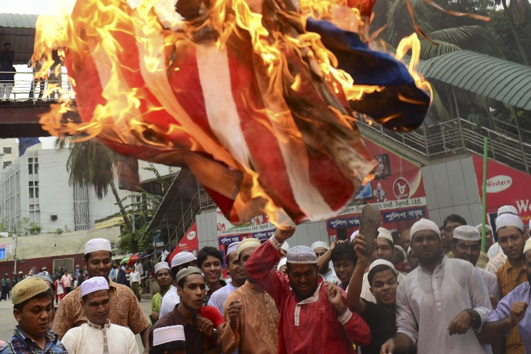 Islamic party activists set fire to a US flag during a protest against an internet film mocking Islam in Dhaka, Bangladesh. ©AFP
