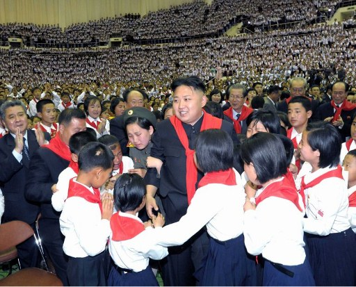 North Korean leader Kim Jong-Un (C) at a concert to celebrate the 66th anniversary of the Korean Children's Union (KCU). ©AFP PHOTO / KCNA via KNS