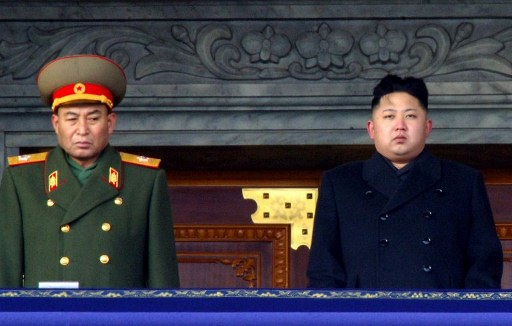 Kim Jong-Un (R) together with North Korea's army chief Ri Yong-Ho (L). ©AFP PHOTO /KCNA