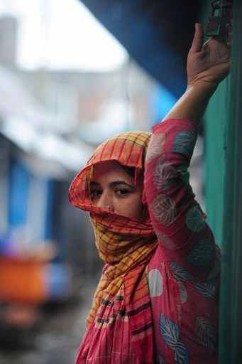 A Bangladeshi sex worker looks on at a brothel. ©AFP