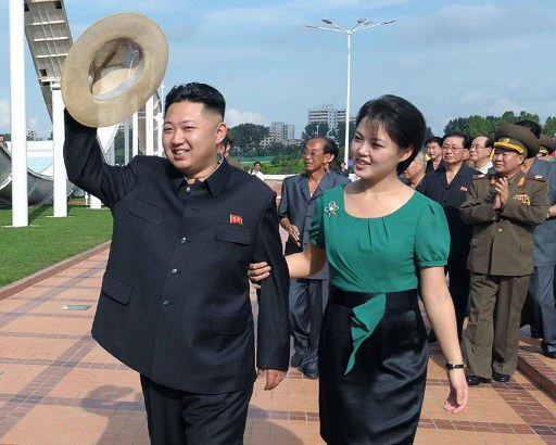North Korean leader Kim Jong-Un (L), accompanied by his wife Ri Sol-Ju (R). ©AFP PHOTO / KCNA via KNS