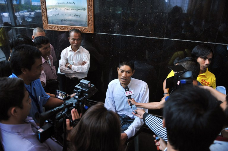 Win Zaw Oo (C) speaks to the media at the international airport in Yangon. ©AFP
