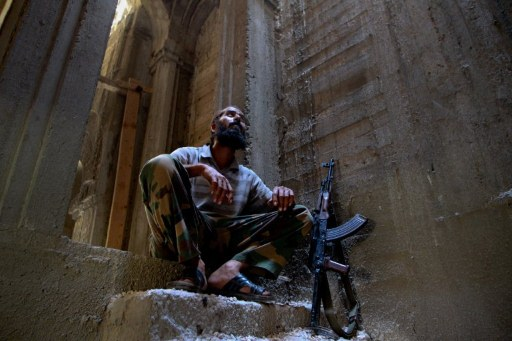 A Libyan rebel rests as he takes cover from mortar shelling in an unfinished mosque on the outskirts of Sabratha. ©AFP
