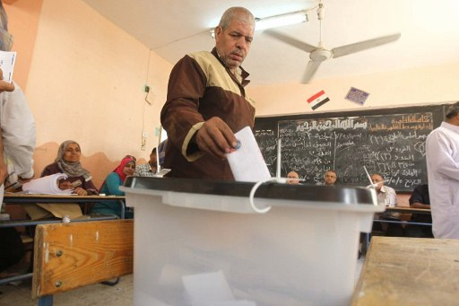 An Egyptian man casts his ballot on the second day of Egypt's historic presidential election. @AFP