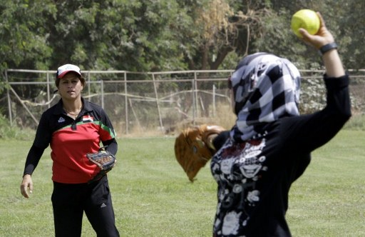 Iraqi softball players take part in a softball course under the tutelage of US coaches at the Baghdad Sports College. ©AFP
