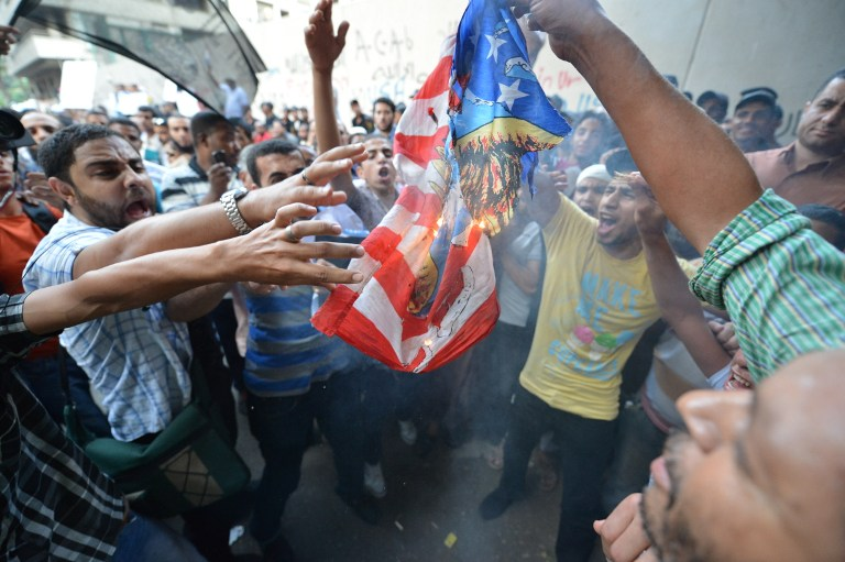 Egyptian protesters burn the US flag during a demonstration against a film deemed offensive to Islam. ©AFP
