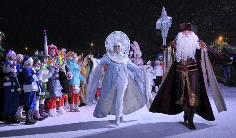Father Frost and Snow Maiden march along a street during the traditional opening of the New Year celebrations in central Stavropol, Russia. ©AFP