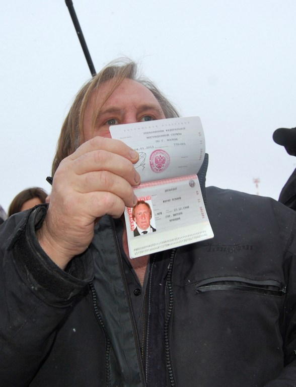 French actor Gerard Depardieu shows off his new Russian passport. ©AFP