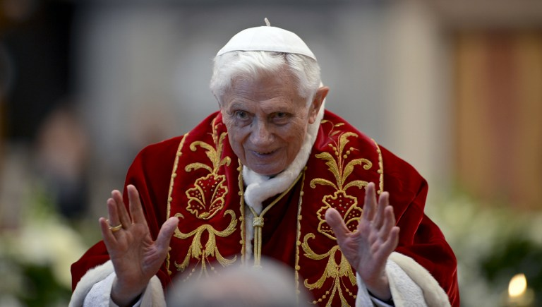 Pope Benedict XVI waves as he leaves after the mass in St.Peter's Basilica to mark the 900th anniversary of the Order of the Knights of Malta, on February 9, 2013 at the Vatican. ©AFP