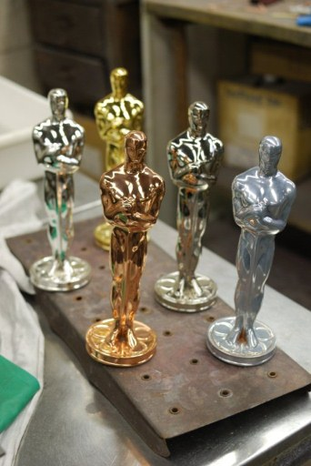 Oscar statuettes at various stages of plating - copper, nickel, silver and 24-carat gold. ©AFP
