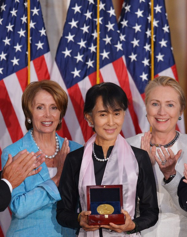 Myanmar's Member of Parliament and democracy icon Aung San Suu Kyi holds the Congressional Gold Medal. ©AFP