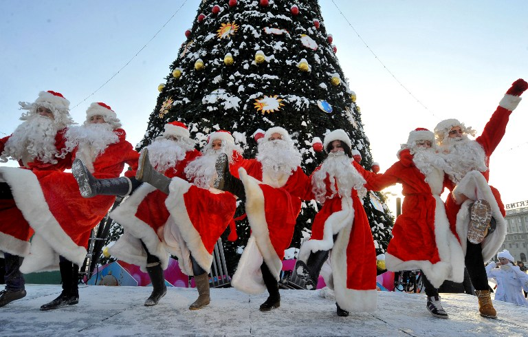 People wearing Father Frost outfits dance during a traditional pre-New Year parade in central Minsk, Belarus. ©AFP