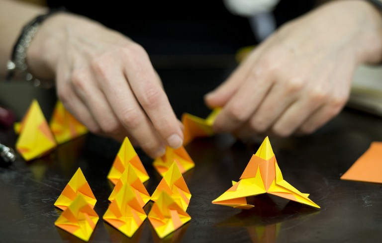 A student makes a Bascetta Star during an Origami class at the Origami Convention. ©AFP