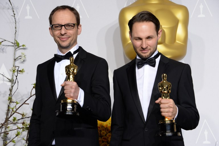 Filmmakers Laurent Witz (L) and Alexandre Espigares pose with their Best Short Film, Animated award for 'Mr. Hublot'