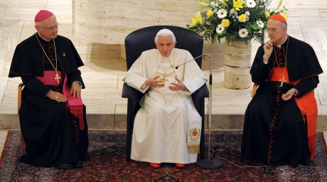 Pope Benedict XVI, sits next to Vatican Secretary of State Cardinal Tarcisio Bertone (R) and Archbishop Robert Zollitsch. ©Reuters