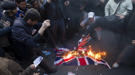 Protesters burn a British flag taken down from the British embassy in Tehran. ©REUTERS