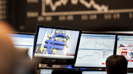 A trader sitting in front of screens showing the German DAX index in Frankfurt am Main at the German Stock Exchange. ©AFP