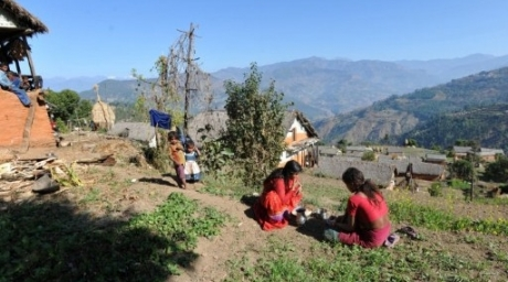 Chandrakal Nepali (C) eats as children look on in the village of Achham. ©AFP