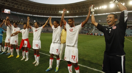 Tunisia's players celebrate after their 2012 African Nations Cup qualifying soccer match victory over Togo. ©REUTERS/Zoubeir Souissi