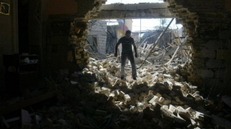 An Iraqi man inspects damages at the Mar Afram Syriac Orthodox Church after an explosion. ©AFP