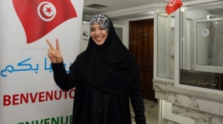 A supporter of Tunisia's Islamist Ennahda party celebrates on October 25, 2011 at the party's headquarters in Tunis. ©AFP
