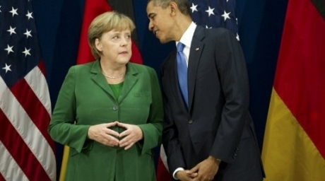 US President Barack Obama (R) talks with German Chancellor Angela Merkel during their bilateral meeting. ©AFP