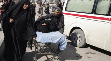 Residents wheel a stretcher carrying a wounded woman after a bomb attack. ©Reuters