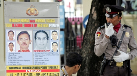 A poster showing wanted suspected Malaysian terrorists Azahari Husin (in poster, L) and Noordin M. Top on a Jakarta street November 10, 2005. ©Reuters