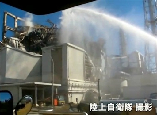 Fukushima nuclear plant being cooled with water @AFP