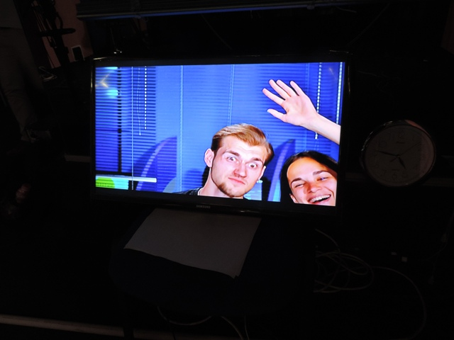 A studio TV monitor catches Dima and Julia clowning. Photo by Hal Foster