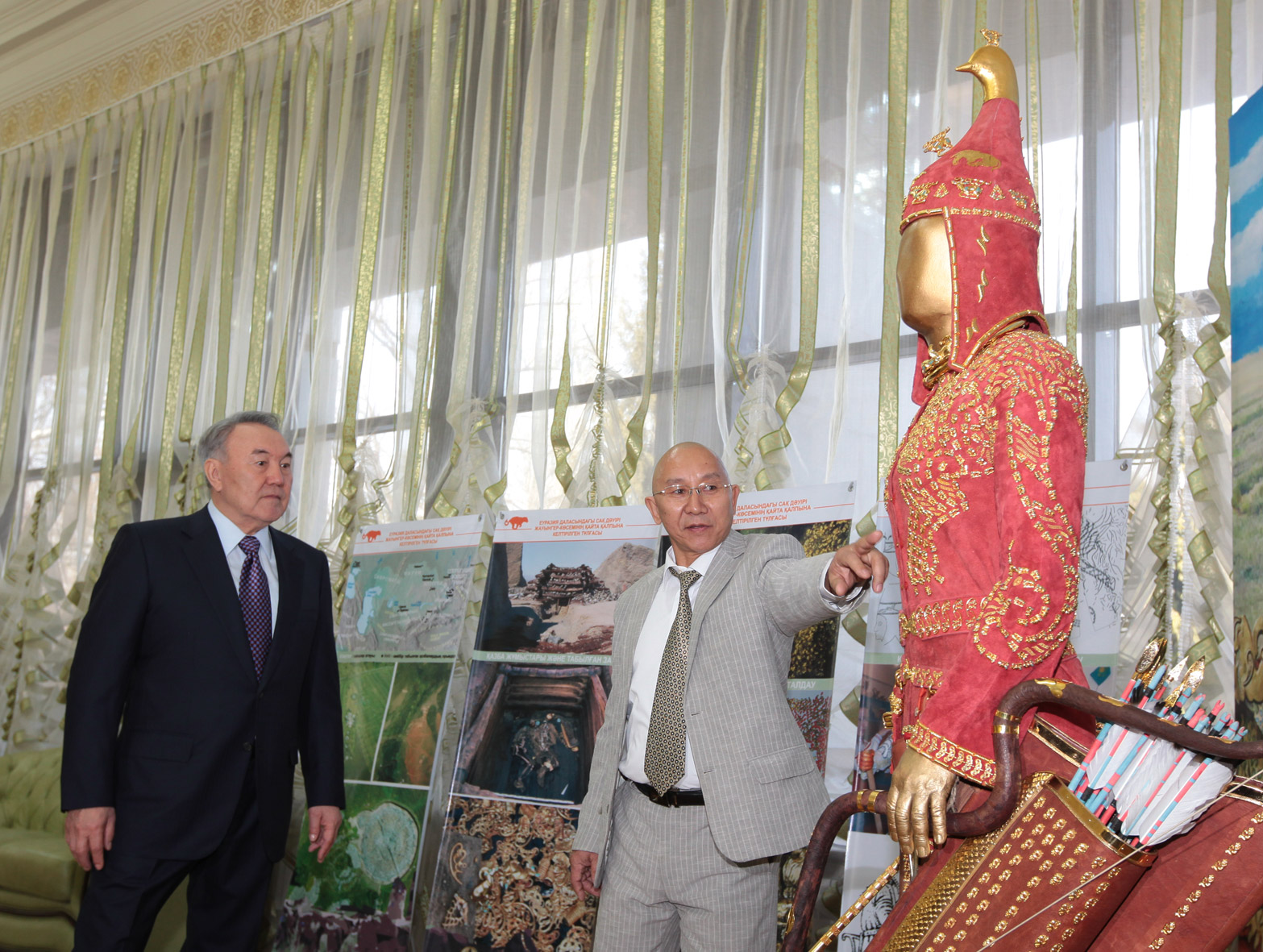 Kyrm Altynbekov shows President Nursultan Nazarbayev his family's reconstruction of the garb of a Saka warrior. Photo courtesy of Krym Altynbekov