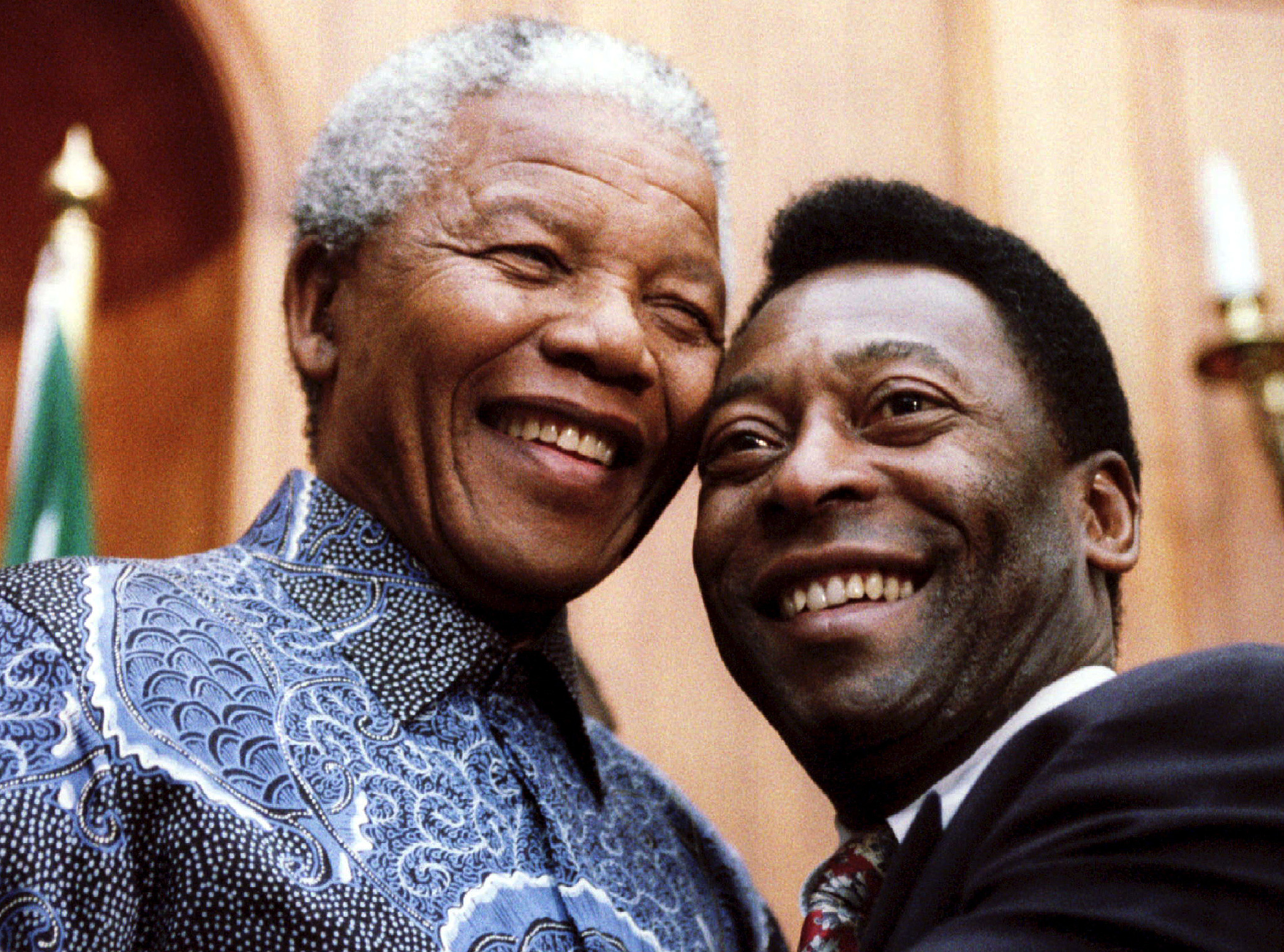 President Nelson Mandela (L) and the world's most famous footballer Pele smile for photographers at Union Buildings March 24. Pele, who is the Brazilian Minister of Sport, is in the country to organise a visit by the Brazilian World Cup team. REUTERS/ Juda Ngwenya