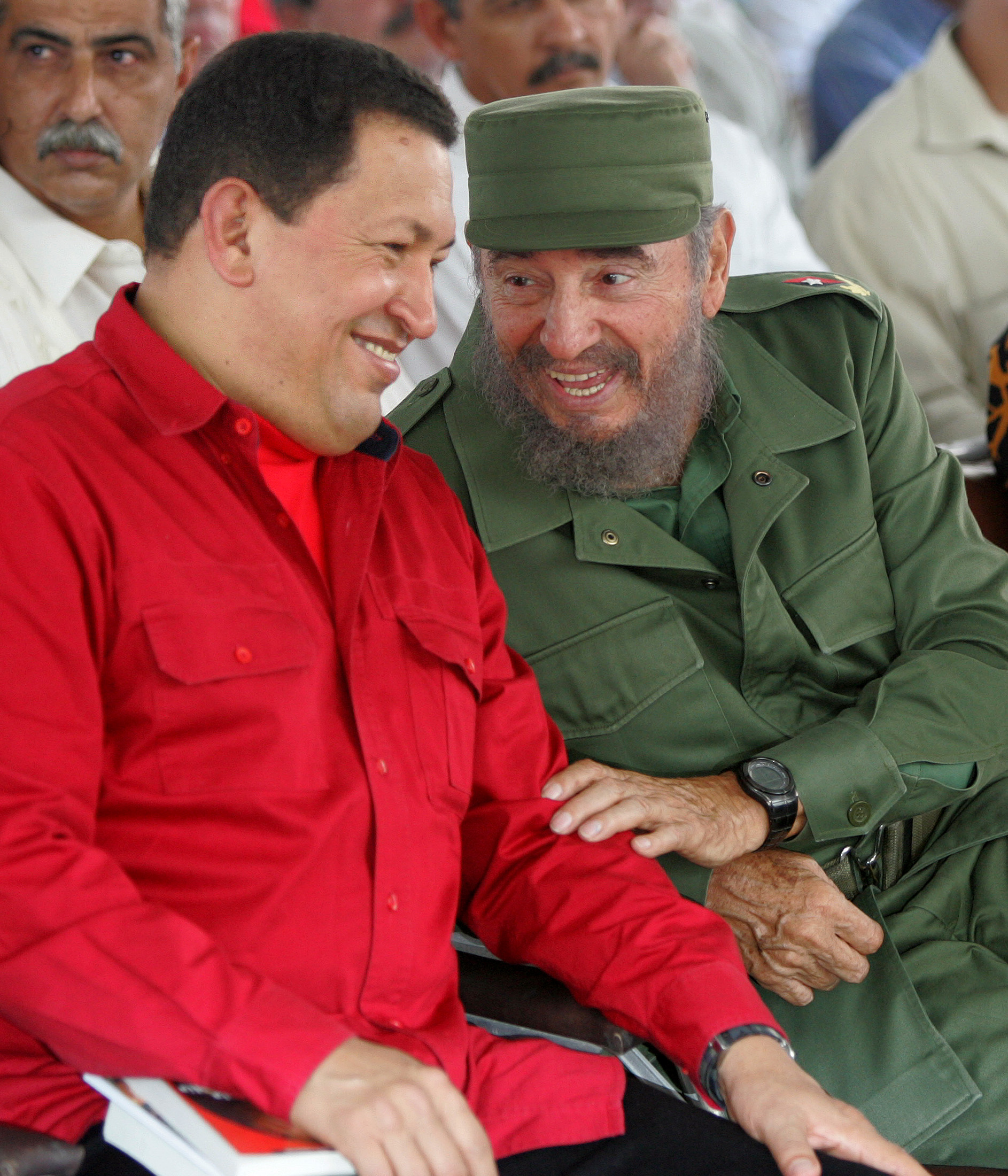 Cuban President Fidel Castro (R) and his Venezuelan counterpart Hugo Chavez share a laugh during the opening ceremony of the International Book Fair in Havana February 3, 2006. ©REUTERS/Claudia Daut